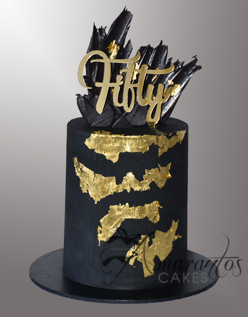 AC532 black and gold drip cake