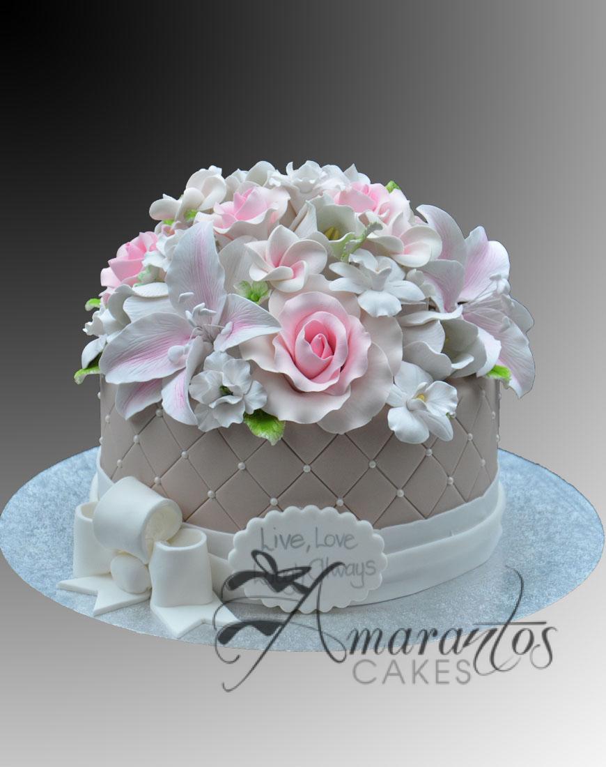 AC62 round with sugared flowers WM Amarantos Cakes