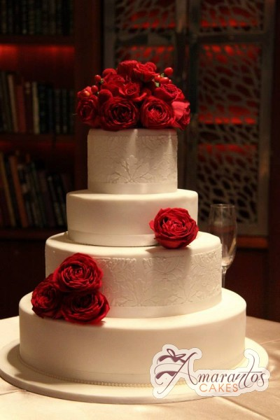 Four tier with fresh red roses